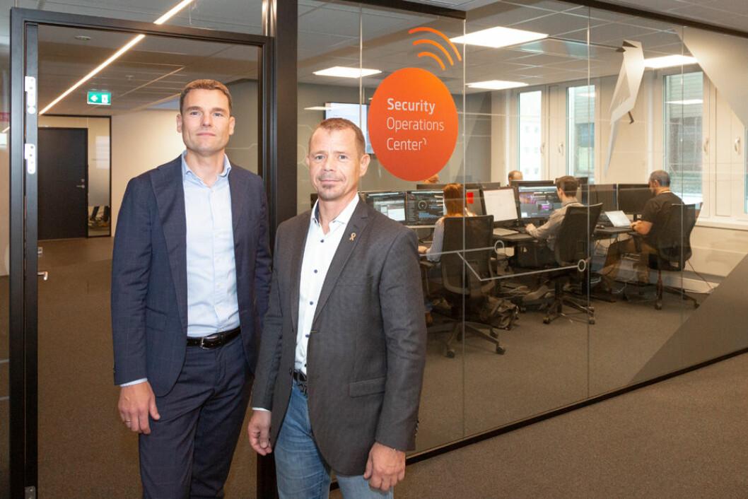 Nils-Erik Auråker, outsourcingdirektør i Sopra Steria sammen med sikkerhetssjef Ronald Barø i UDI (foto: Sopra Steria).